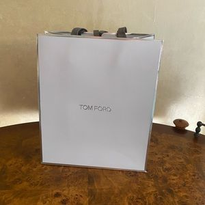 Tom Ford grey and silver paper gift bag.